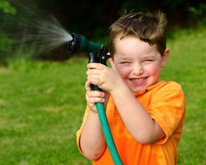 Kid with water hose