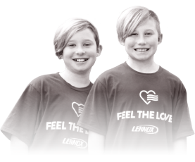 Two kids wearing Feel The Love t-shirts