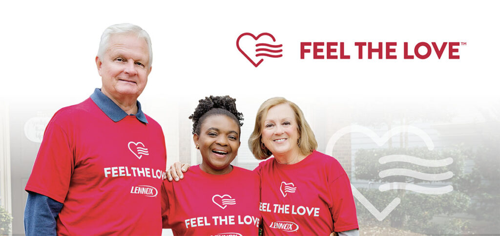 A man and two women stand together with Feel The Love t-shirts on